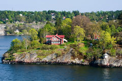 Picturesque houses on the islands. Spring, Scandinavia Stock Images