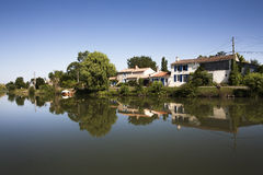 Picturesque houses near the water in France Royalty Free Stock Photos
