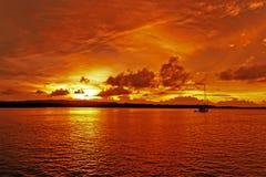 Golden & orange colored coastal cloudy sunrise seascape. stock photos