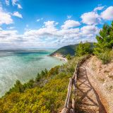 Picturesque islets Faraglioni di Puglia in summer Adriatic sea bay Baia Delle Zagare. Mattinata Faraglioni stacks and beach coast of Mergoli, Vieste Gargano stock photo
