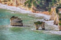 Picturesque islets Faraglioni di Puglia in summer Adriatic sea bay Baia Delle Zagare. Mattinata Faraglioni stacks and beach coast of Mergoli, Vieste Gargano royalty free stock photos