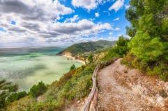 Picturesque islets Faraglioni di Puglia in summer Adriatic sea bay Baia Delle Zagare. Mattinata Faraglioni stacks and beach coast of Mergoli, Vieste Gargano royalty free stock images