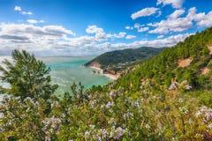 Picturesque islets Faraglioni di Puglia in summer Adriatic sea bay Baia Delle Zagare. Mattinata Faraglioni stacks and beach coast of Mergoli, Vieste Gargano stock photography