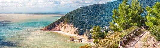 Picturesque islets Faraglioni di Puglia in summer Adriatic sea bay Baia Delle Zagare. Mattinata Faraglioni stacks and beach coast of Mergoli, Vieste Gargano stock images
