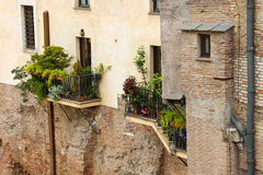 Picturesque Italian house with flowers on the balconies Royalty Free Stock Photo