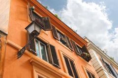 Picturesque Italian house with flowers on the windows Stock Photos
