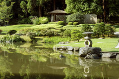 Picturesque Japanese garden with pond Stock Images