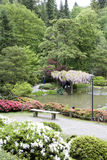 Picturesque Japanese Garden. Visitors were enjoying Seattle Japanese Garden on Saturday afternoon. The garden was filled with spring flowers Stock Photos