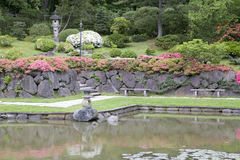 Picturesque Japanese Garden. Zen garden with beautiful flowers and pond Stock Photography