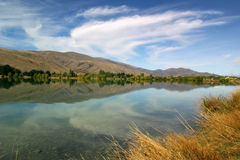 Picturesque lake. Scenic view of cloudscape reflected on picturesque lake in countryside Stock Photo