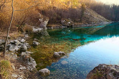 Picturesque Lake Cornino in the north of Italy. With beautiful pure fresh azure watres, surrounded by high rocky mountains on the Alps, a natural reserve Royalty Free Stock Image