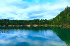 Picturesque lake in the forest Stock Photos