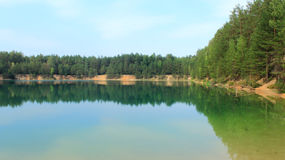 Picturesque lake in the forest Stock Images