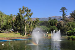 Picturesque lake with fountains and a rainbow Stock Photography