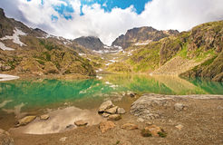 The picturesque lake in the French Alps in the array Lac Blanc. Stock Image