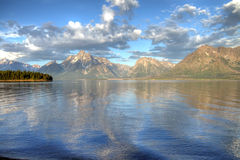 Picturesque lake and mountains. Mountains and cloudscape reflecting in Jackson Lake, Grand Teton National Park, Wyoming, U.S.A stock image