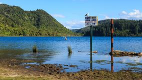 Picturesque Lake Tikitapu or the Blue Lake in the Rotorua region, New Zealand. Lake Tikitapu is one of the many attractive lakes near Rotorua in the Bay of stock image