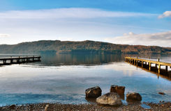 Picturesque Lake With Wooden Jetties Royalty Free Stock Photos