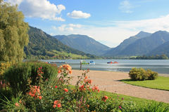 Picturesque lakeside promenade with flowerbed, schliersee, germany. Picturesque lakeside promenade with flowerbed, lake schliersee, germany stock photos