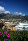 Picturesque Landscape. Image of Camps Bay beneath the striking mountain range of the 12 Apostles in Cape Town, South Africa Royalty Free Stock Images