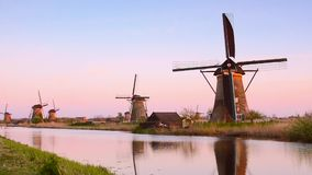 The picturesque landscape with aerial mills on the channel in Kinderdiyk, Netherlands at sunset. Full HD video. stock video