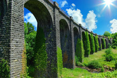 Picturesque landscape with ancient railway bridge. Stock Images
