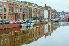 Picturesque landscape with beautiful traditional houses reflection in canal, Haarlem, Holland Royalty Free Stock Image