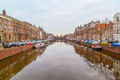 Picturesque landscape with beautiful traditional houses reflection in canal, Haarlem, Holland Royalty Free Stock Photography