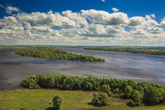 The picturesque landscape with big river under the  clouds. Royalty Free Stock Image