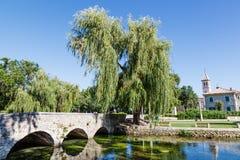 Picturesque Landscape, Church, Bridge. Picturesque Landscape, Church and Bridge, River and Willow in Solin, Croatia Royalty Free Stock Photos