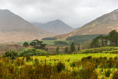 Picturesque landscape in Connemara. Picturesque irish landscape in Connemara mountains on a rainy day Royalty Free Stock Photo