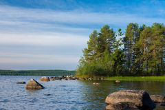 Picturesque landscape with forest and lake. Onega lake