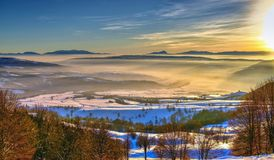 Beautiful foggy mountain landscape at sunset stock photography
