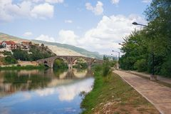 Picturesque landscape with old stone bridge. Bosnia and Herzegovina, Trebinje. View of Trebisnjica river and Arslanagic Bridge. Picturesque landscape with old royalty free stock photography