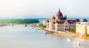 The picturesque landscape of the Parliament and the bridge over the Danube in Budapest, Hungary, Europe in pastel colors.  stock photos