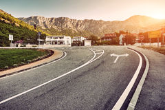 Picturesque landscape scene and sunrise above road Royalty Free Stock Photo