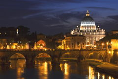 Picturesque landscape of St. Peters Basilica over Tiber in Rome, Italy Stock Photo