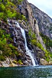 The picturesque landscape: waterfall, rocks and sea Stock Photos