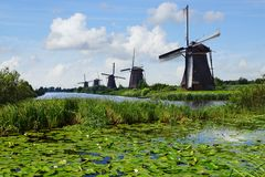 Picturesque landscape with windmills. Kinderdijk Royalty Free Stock Image