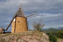 Picturesque Languedoc-Roussillon - St-Chinian. The restored windmill on the hill above St Chinian, Languedoc-Roussillon, France, Europe Stock Image
