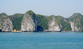 Picturesque limestone island in the ocean stock photos