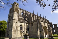 Picturesque Malmesbury Abbey. Historic Malmesbury Abbey in spring sunshine, Wiltshire, UK Royalty Free Stock Photos