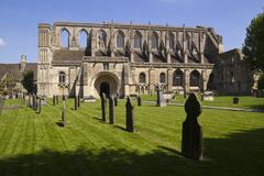 Picturesque Malmesbury Abbey. Historic Malmesbury Abbey in spring sunshine, Wiltshire, UK Royalty Free Stock Images