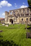 Picturesque Malmesbury Abbey. Historic Malmesbury Abbey in spring sunshine, Wiltshire, UK Stock Images