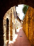 Picturesque medieval narrow street of San Gimignano old town, Tuscany, Italy Royalty Free Stock Photos