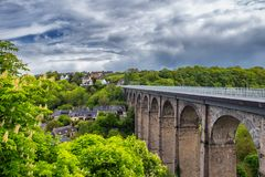 The picturesque medieval port of Dinan on the Rance Estuary, Brittany (Bretagne), France royalty free stock images
