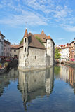 The medieval prison in the middle of a large city canal Stock Photos