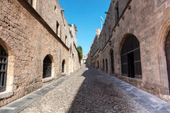 Picturesque medieval street in Rhodes Old Town. Royalty Free Stock Images
