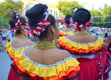 Picturesque Mexican women clothing. Hairstyles accessories from behind at Varna square Bulgaria.August 3rd 2014 Stock Photography