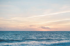 Picturesque morning sky at sunrise and ocean with Royalty Free Stock Images